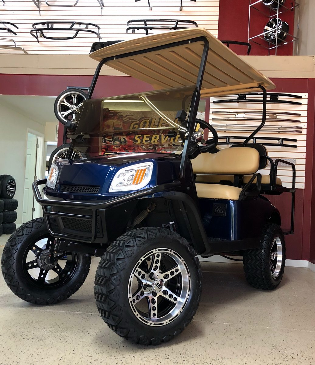 Blue EZGO Terrain lifted with custom wheels & rims