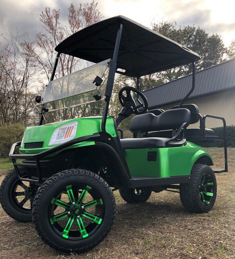 Monster Green EZGO Terrain lifted with custom rims