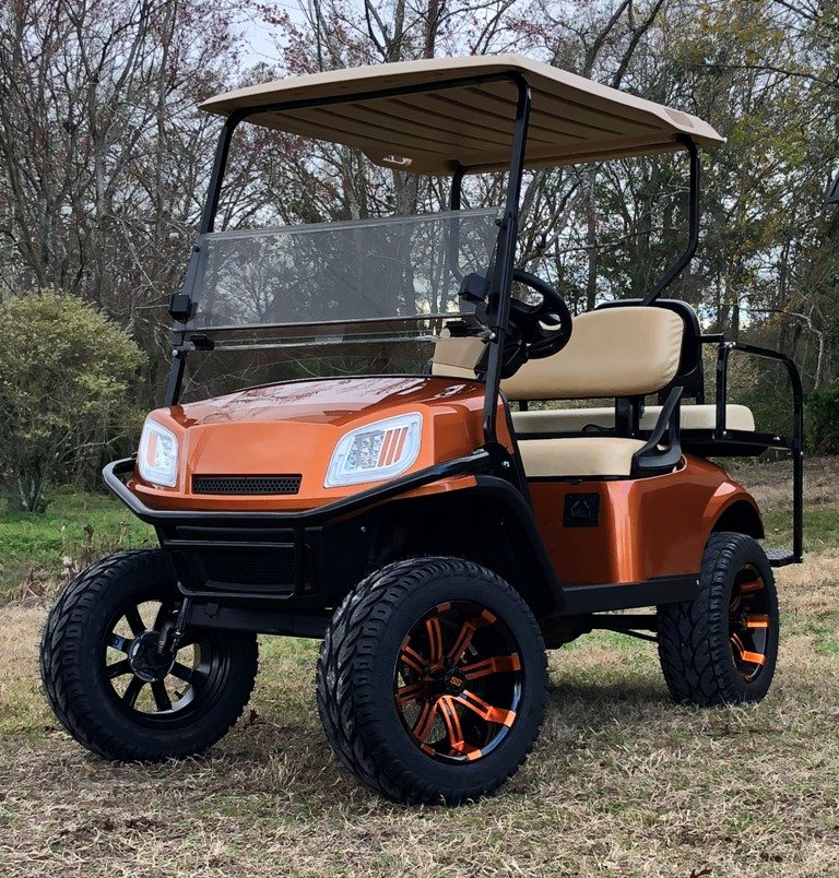 Burnt Orange EZGO Terrain lifted with custom rims