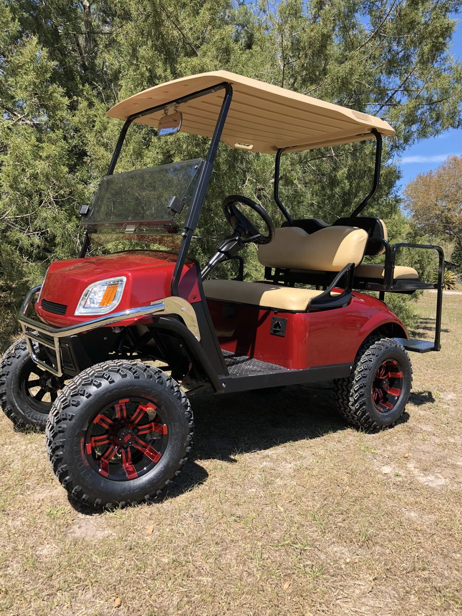 Inferno Red EZGO lifted with custom wheels