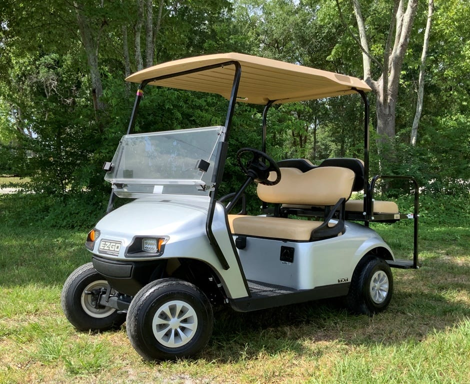 ice blue ezgo 2 pass with short beige top and std beige seats
