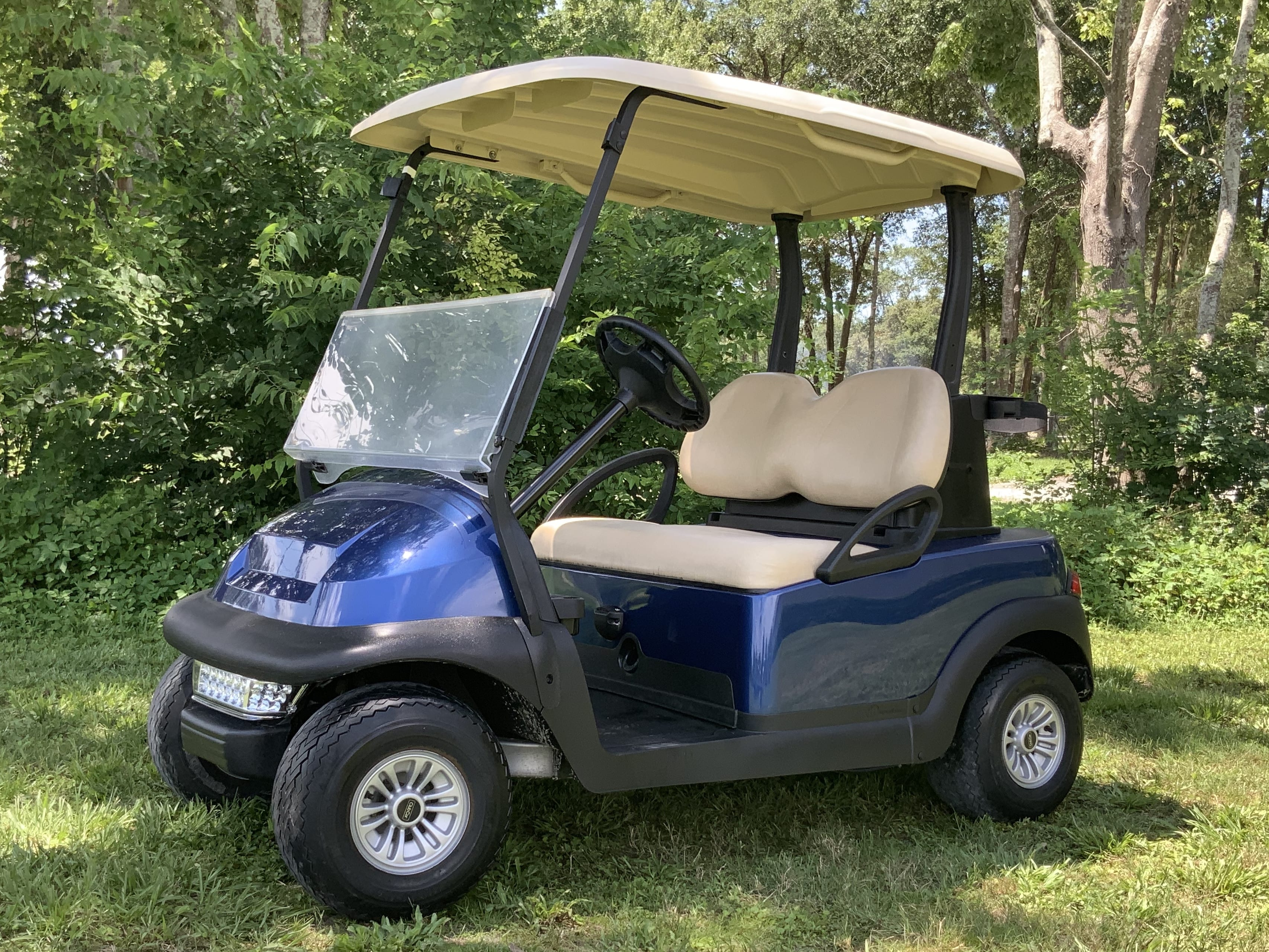 Club Car blue with standard beige seats and beige top 2 pass stock 1321