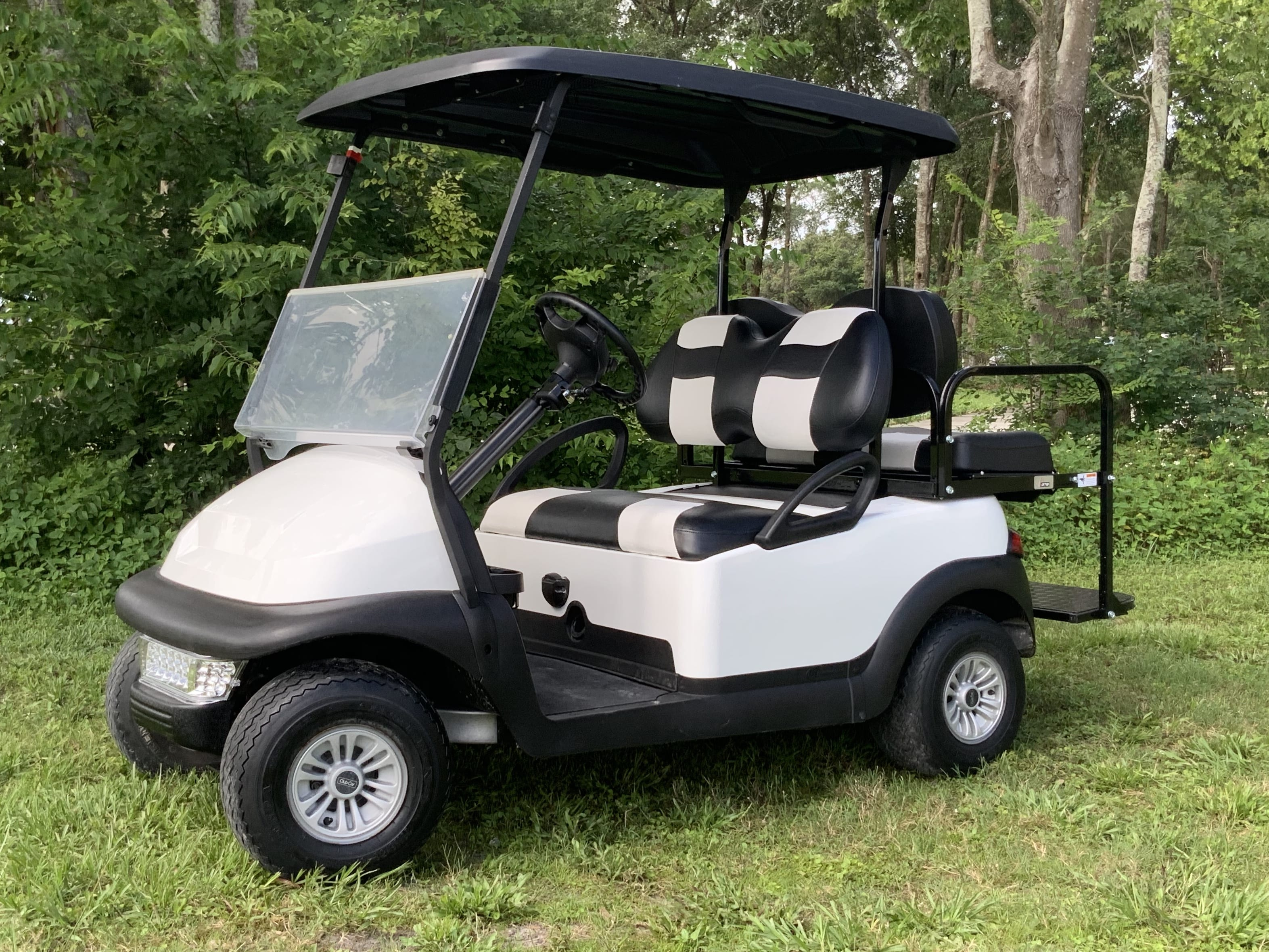 WHITE CLUB CAR WITH BLACK AND WHITE SEATS FOUR PASSENGER